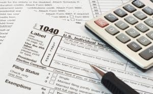 Form 1040 top left corner with calculator top right