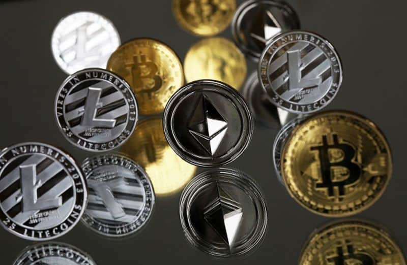 litecoin and bitcoin photo of tokens of their logos