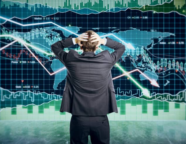 Investor standing in front of world market charts all showing downward values as example of what happens when bad news hits crypto markets