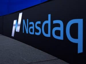 Wrap around Nasdaq wall print in building. Black background with blue text
