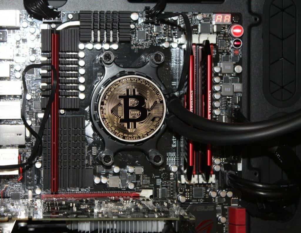 Bitcoin token on circuit board represents digital currency and blockchain